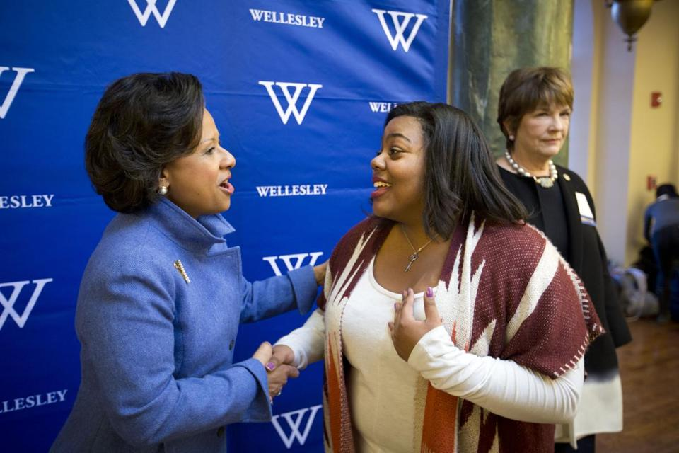 Wellesley College sophomore Gabrielle Taylor (right) greeted   Paula A. Johnson, the school's new president, during a reception after Johnson addressed students at Alumnae Hall on Thursday.